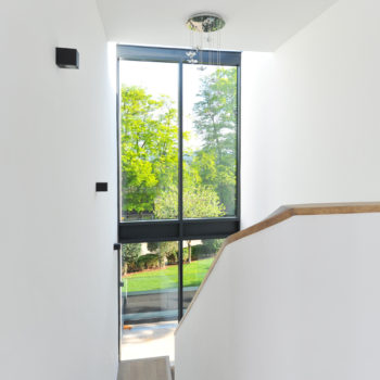 Double height windows accentuate the staircase