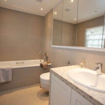 Bathroom with warm neutral tiles