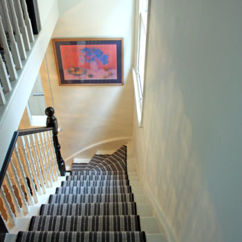 Stripe stair runner carpet to emphasis new staircase