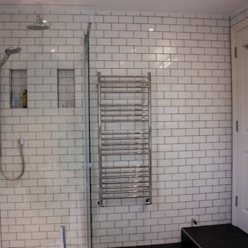 White Metro style tiles in Bathroom by DNA Architecture